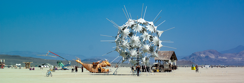 RadiaLumia was a geodesic sphere, five-stories tall, and covered with a breathing skin of origami shells and radiant spikes. Art by FoldHaus Collective, Oakland, CA.