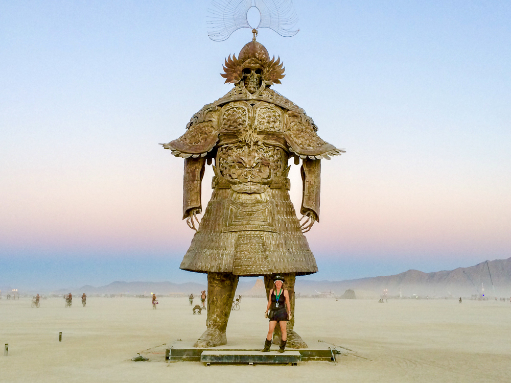 "Making new friends at Burning Man. ""Desert Guard"" by Lu Ming from Beijing, China"