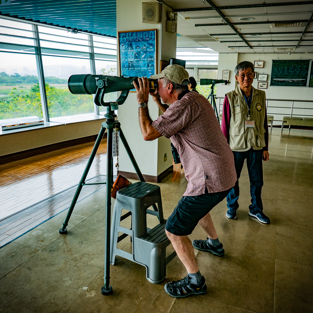 With the help of the docent, Keith takes a look through the largest binoculars I have ever seen.