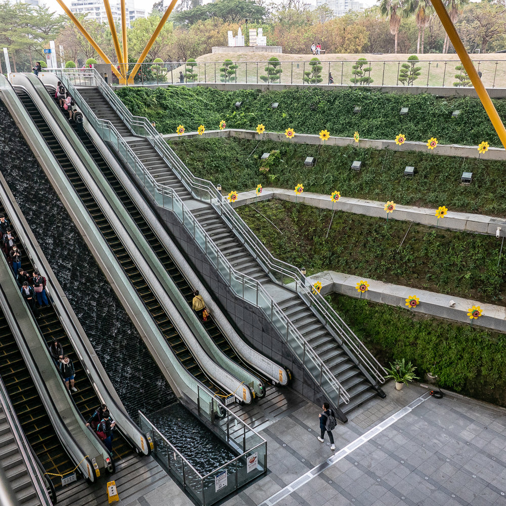 The impressive Central Park Metro Station, with large daisy pinwheels in a vertical garden.