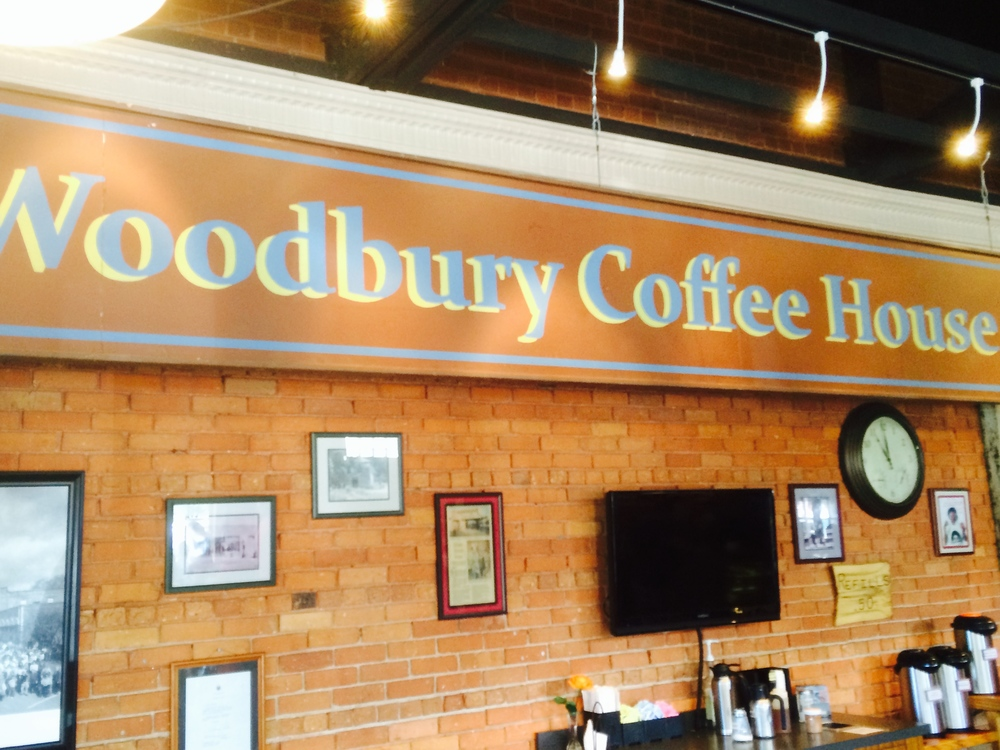 The screen-used Woodbury Coffee House sign hangs inside the Senoia Coffee House and Cafe.