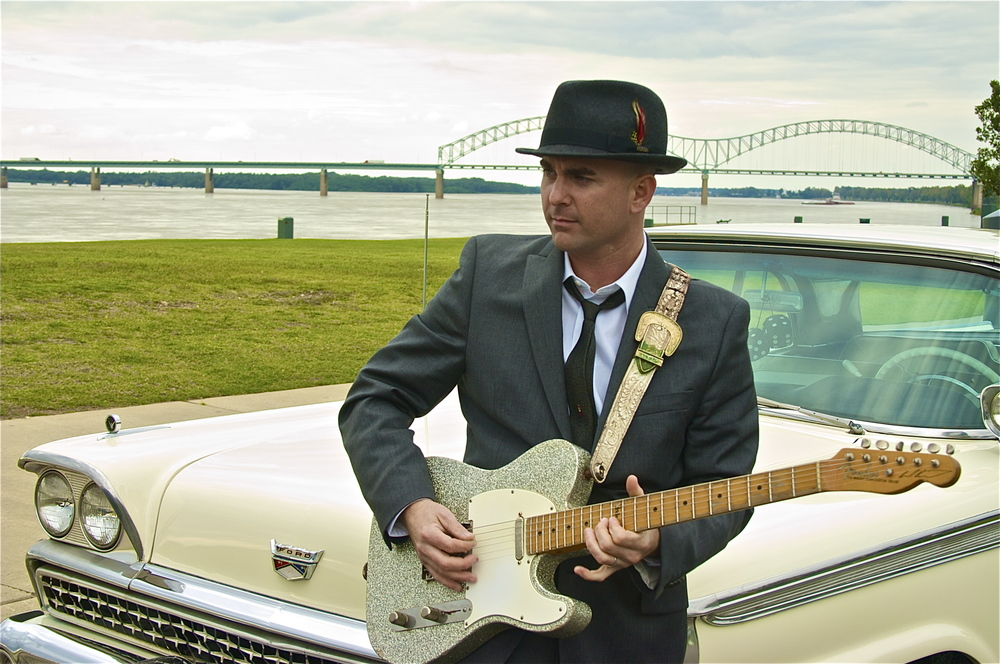 Brad Birkedhal posing in front of his 1959 Ford Fairline 500 Skyliner Galaxie.