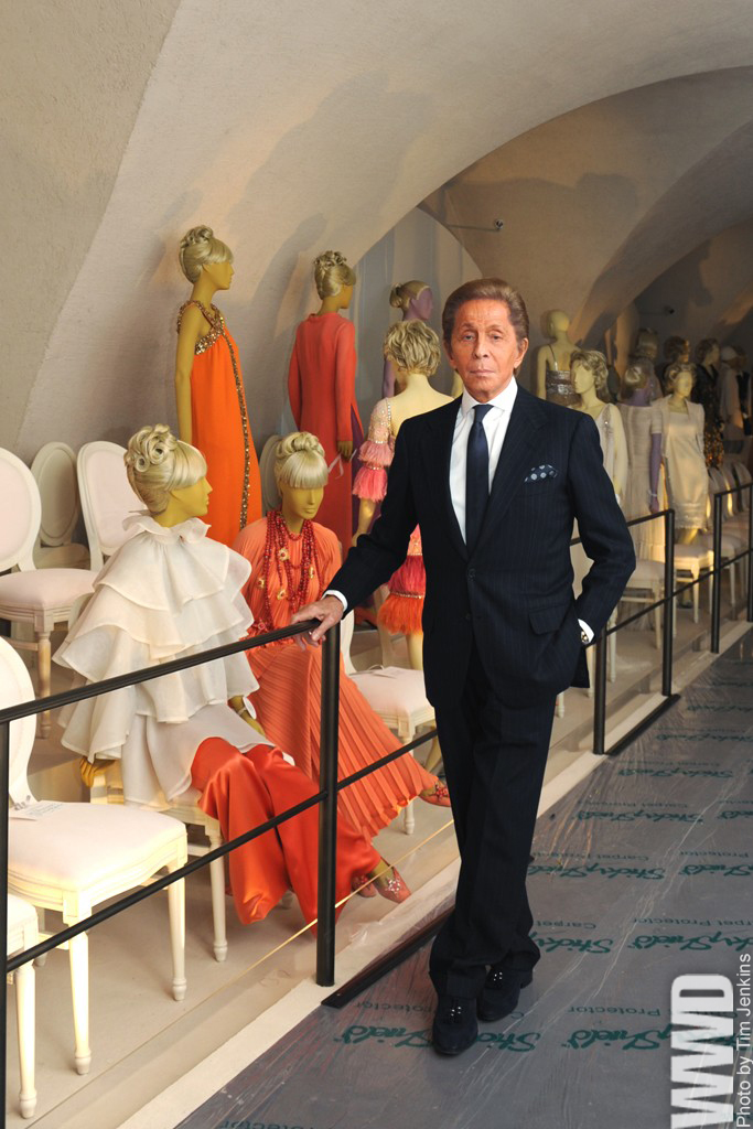 "womensweardaily: Valentino Talks Fashion as Exhibit Hits London Valentino Garavani may have turned 80 earlier this year, but the milestone hasn't made a stitch of difference to the designer. Years after his contemporaries have retired their boots and poles, he's still skiing — at ""my little chalet in Gstaad"" — and said he's barely stopped for breath since he sent out his final couture show in January 2008.  Retirement is a relative term for Valentino and his equally spry business partner and friend Giancarlo Giammetti, who has given over the sitting room of his grand offices on Cadogan Square for an interview. The two, who met in 1960 at Rome's Café de Paris on Via  Vittorio Veneto, and founded the business shortly after, were famously the first designers to live as large as their clients — and they're still at it.  For More"