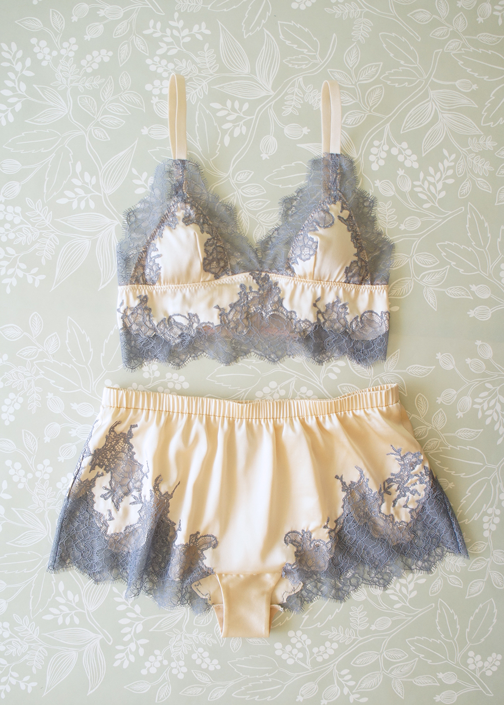 Dove gray floral lace appliquéd by hand on nude cream silk.
