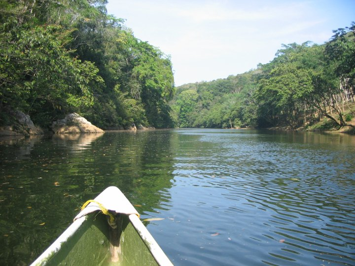 Canoeing down the river to Ix Chel Medicine Trail in San Ignacio.jpg
