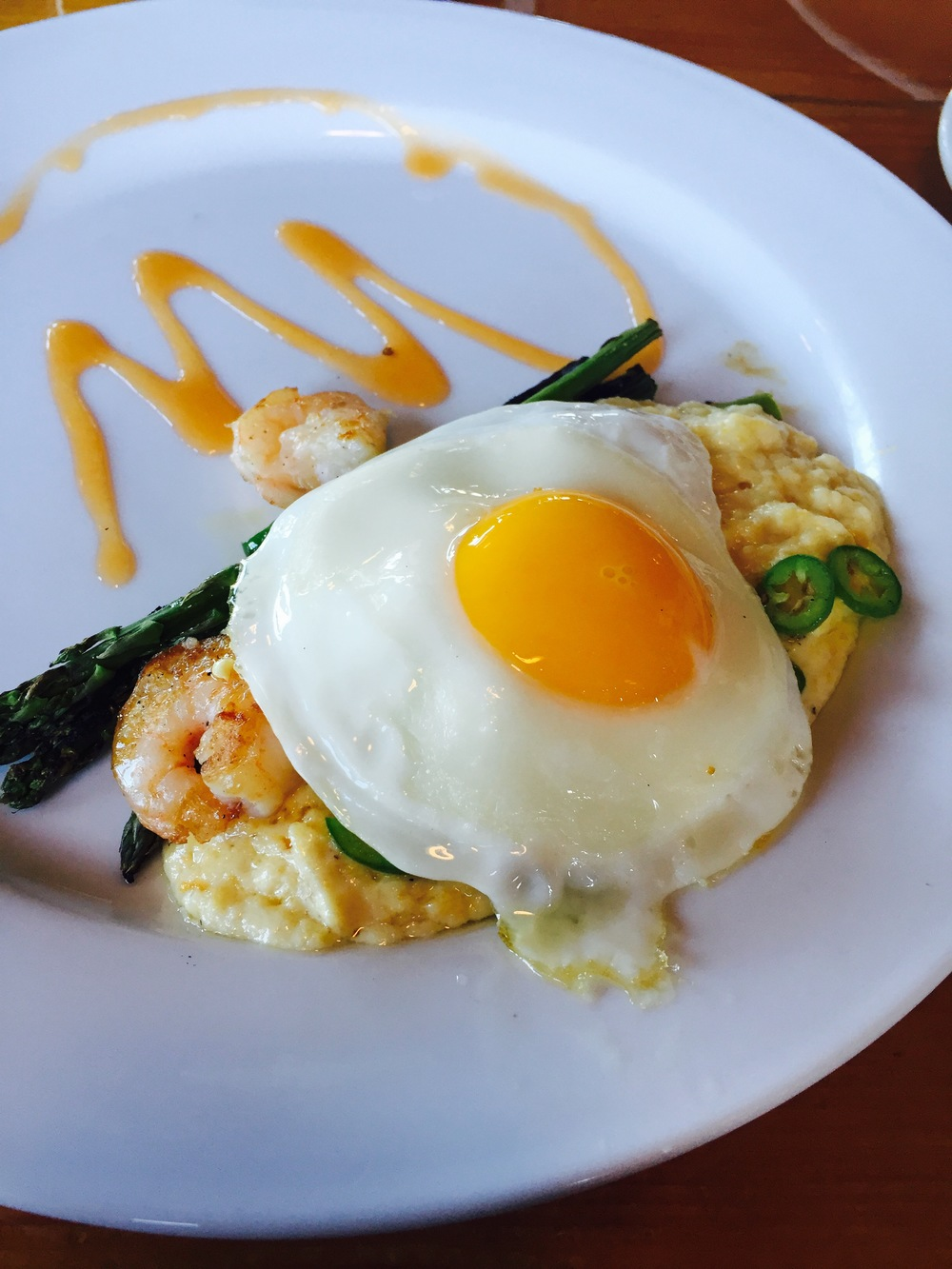 Shrimp n' Grits: chickpeas, asparagus, tomato, serrano, fried egg.