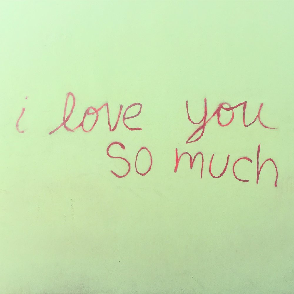 The famous 'I love you so much' mural is on the side of Jo's Coffee.
