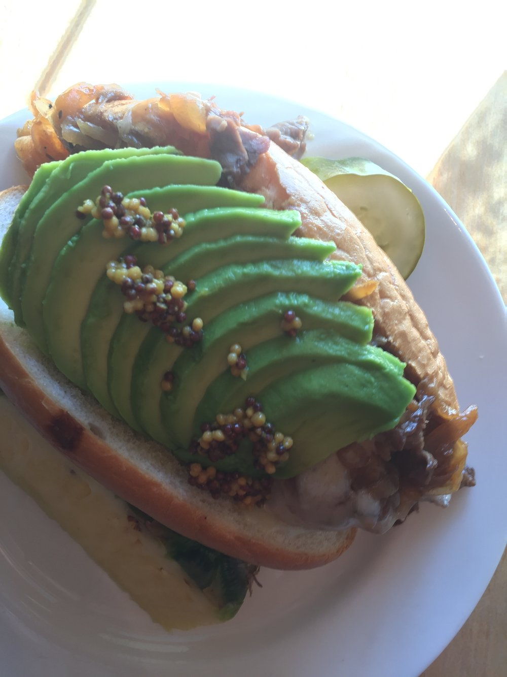 Prime Rib sandwich with caramelized onion, mustard seed and avocado