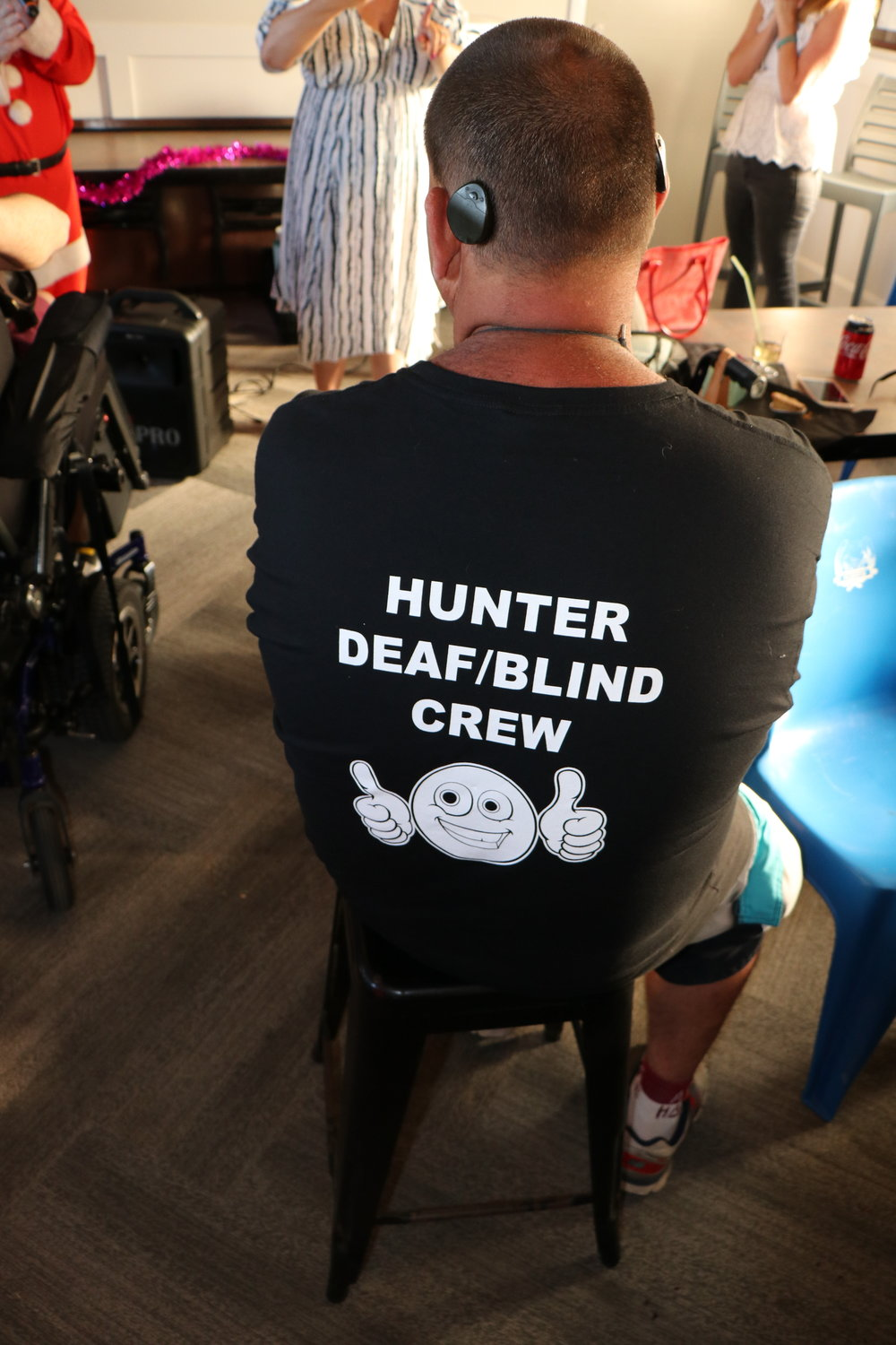 Man with t-shirt that reads Hunter Deaf Blind Crew.
