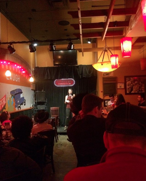 Lot of comics pile in and crane their necks to watch the Flappers Bar open mic.