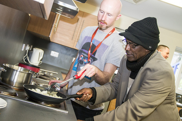 Christopher Hartley (Stockport Homes) and resident Gemta Mohammed cooking up some chilli.
