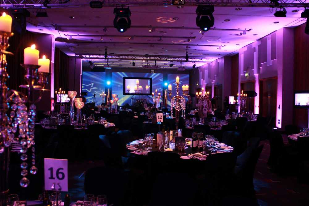 The Grace Suite at Hilton Hotel Liverpool set up with Audio Visual and Staging for a Gala Dinner