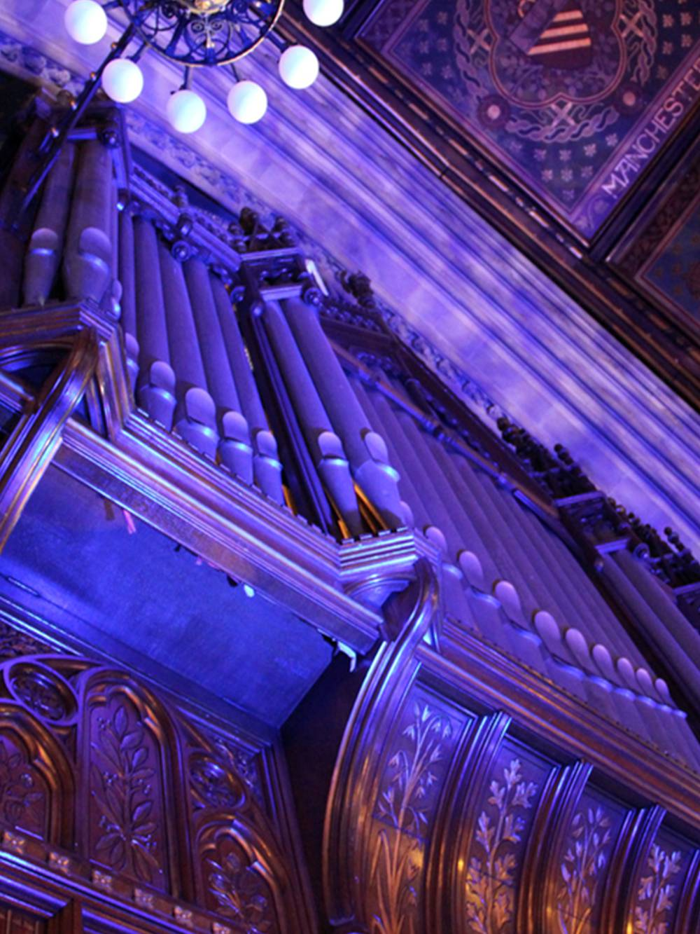 The organ pipes lit using patterns projected by moving lights with gobos and washed in colour with LED uplighters.