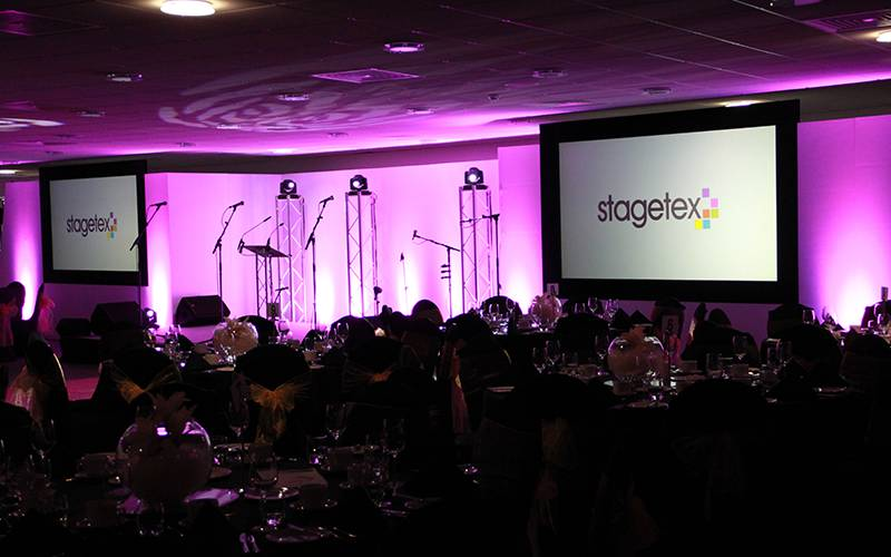 Awards Ceremony stage set at St Helen's Stadium incorporating two large projection screens and lighting.
