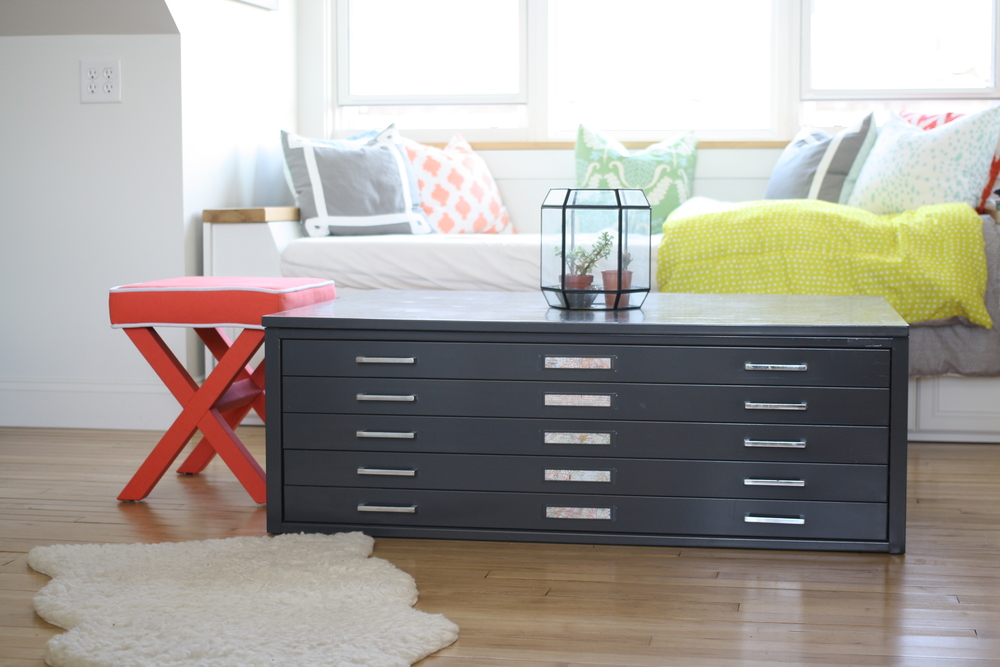 The daybed and vintage flatfile cabinet act as storage along with adding unique style to the loft area.  Additionally, the daybed is a great spot to put a track buddy who needs a place to crash for the evening.