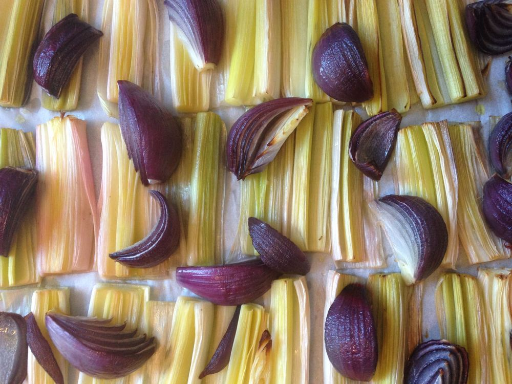 Roasted leeks and red onions ready for wholegrain vinaigrette and toasted hazelnuts