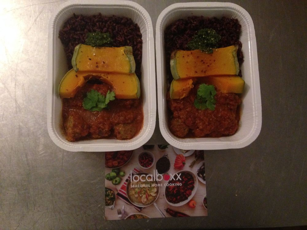 Mexican meatballs with black rice, tomatillo salsa, chipotle pepper sauce, roasted squash