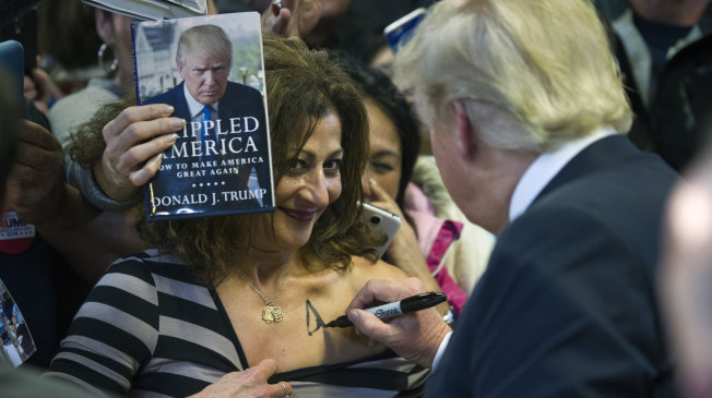 Donald signing them titties...