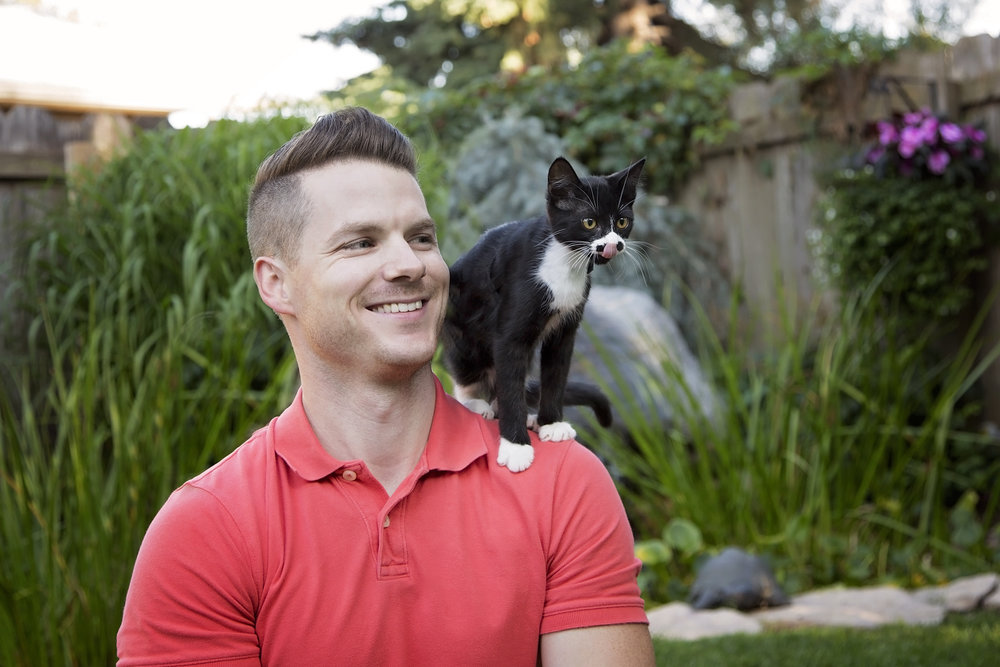 Jason Belanger, Chief Mine Maintenance Engineer of Potash Corp poses with Janny for the 2017 Men With Cats Calendar.