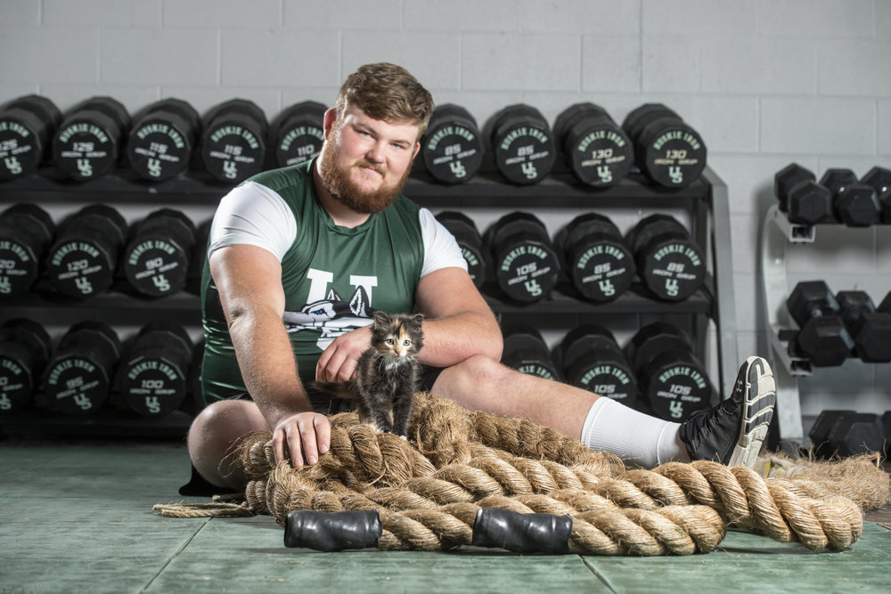 "Mr. September, #61 Ryan Breadner AKA ""Big Tex"" Offensive Lineman of the University of Saskatchewan Huskies Football Club poses for the 2017 Men With Cats Calendar."