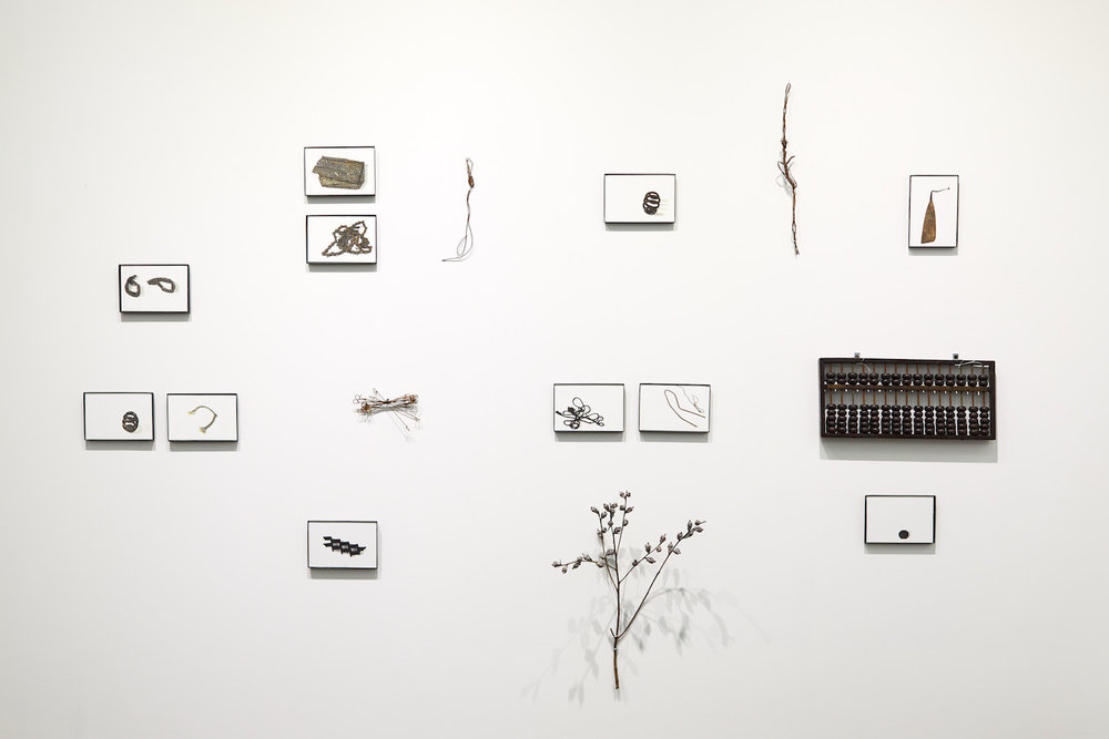 Hood Treasures , by Luisa Duarte, Site specific installation- Studio 122. Photographs, found objects, and an abacus. 5' x 6'