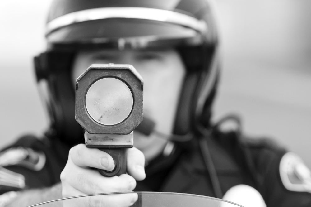 Illinois Speeding Tickets: Police Officer with Radar Gun