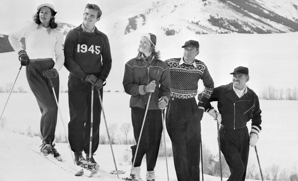 23 Mar 1946, Sun Valley, Idaho, USA — Original caption: Hollywood Stars Ski at Sun Valley. Sun Valley, Idaho: Active sports are the best things in the world to relax one after a session before the Kleig lights, and these Hollywood stars chose skiing as their sport. Shown on a crest at the famed resort at Sun Valley, Idaho are, left to right: Mrs. Gary Cooper, Jack Hemingway, Ingrid Bergman, Gary Cooper and Clark Gable. Used by the Navy during the war, the resort will be opened to the public in the fall of 1946.
