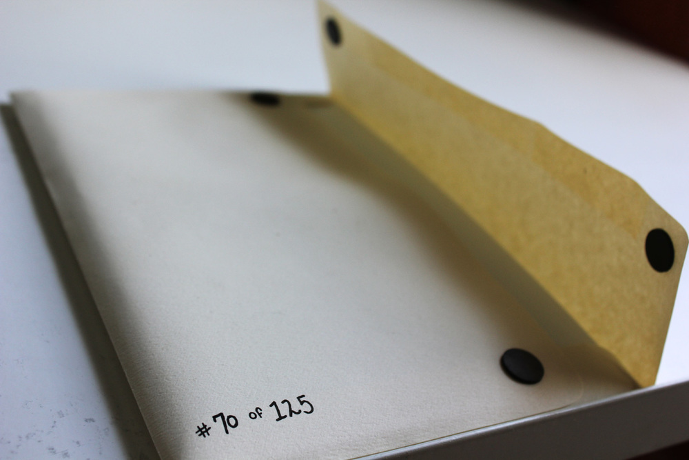 Each book sleeve magnetizes shut and is hand numbered.