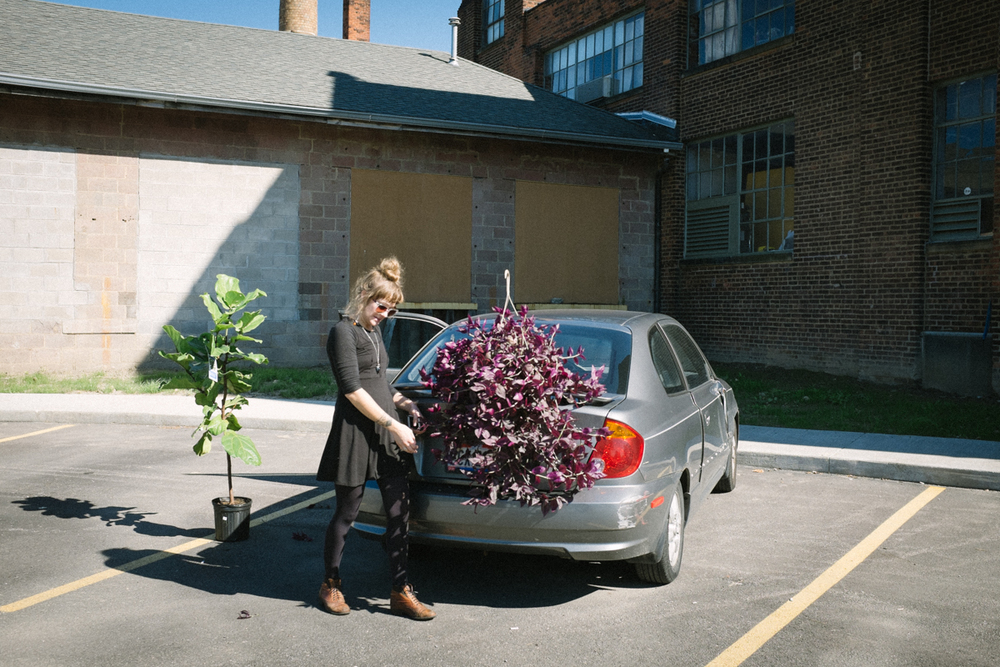 Alex with plants | Photo by Peter Larson
