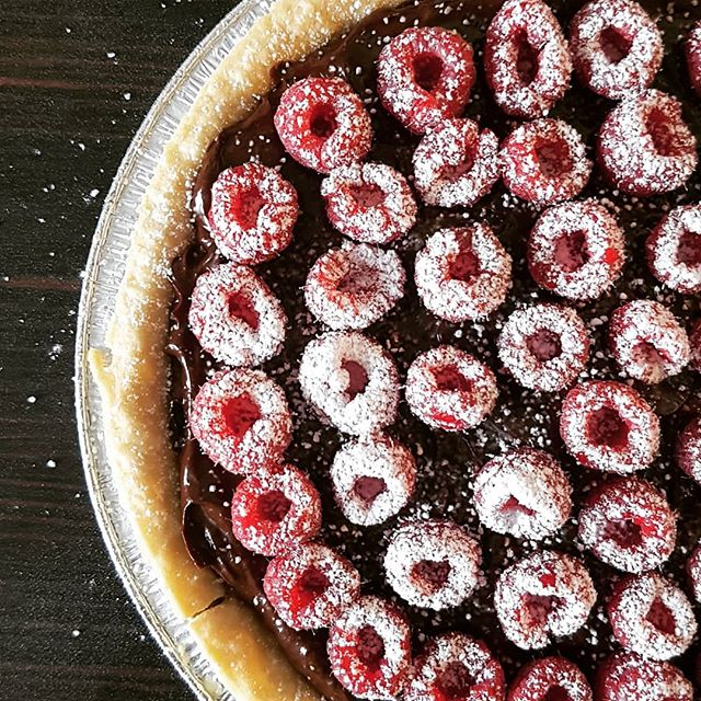 Despite being a cookbook publisher I rarely cook recipes from cookbooks exactly as suggested. I love pulling recipes apart and putting together different ideas from different recipes. Here is a pie full of the dark choc ganache from the @heirloomveg Tiramisu recipe (pg 106 The Plant-based Foodie) topped with raspberries. Took about 20 minutes and I'm not going to tell my non-veg friends that it's vegan until the inevitably ask for the recipe!