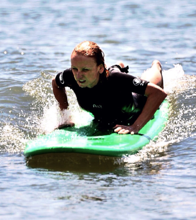 Surfing in Ocean City, NJ. I was having so much fun that I didn't realize I'd sprained my toe until I stopped to rest.