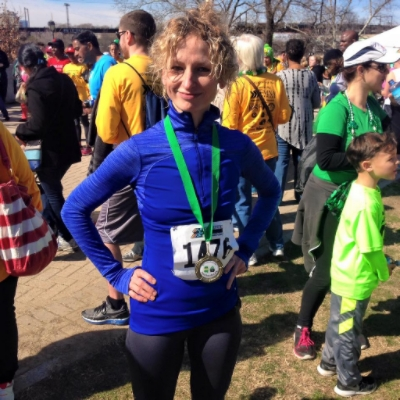 Wearing my Under Armour Long-Sleeve top in the Leprechaun 5-Miler in March 2016. (1st place age group, 7th woman overall.) Also wearing Road Runner Sports capris.