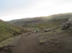 Hiking to Reykjadur hot springs .  Going down was much easier than going up (except for the mud). 15% grade most of the way, sometimes steeper.