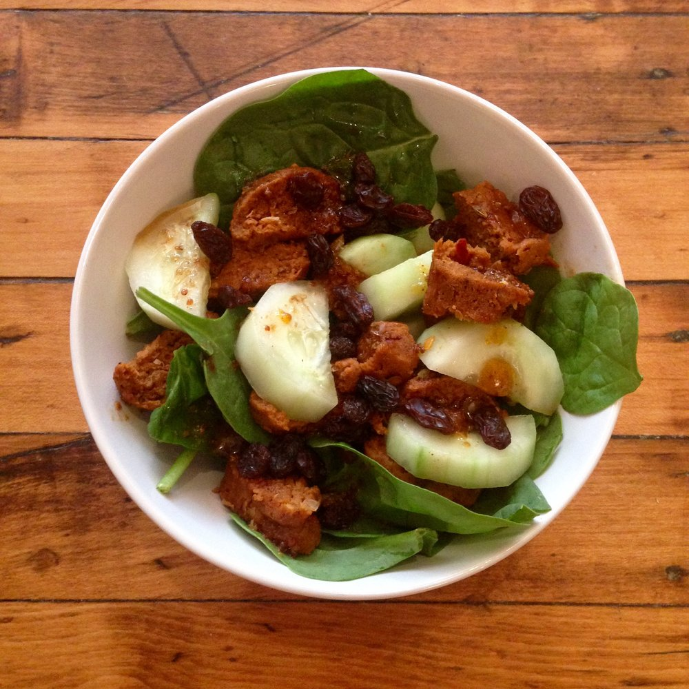 I threw together this salad with sliced Mexican sausages, spinach, cucumbers, and raisins.
