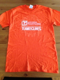Standard local 5K T-shirt. Men's sizes of course. I like the fact that it's orange!