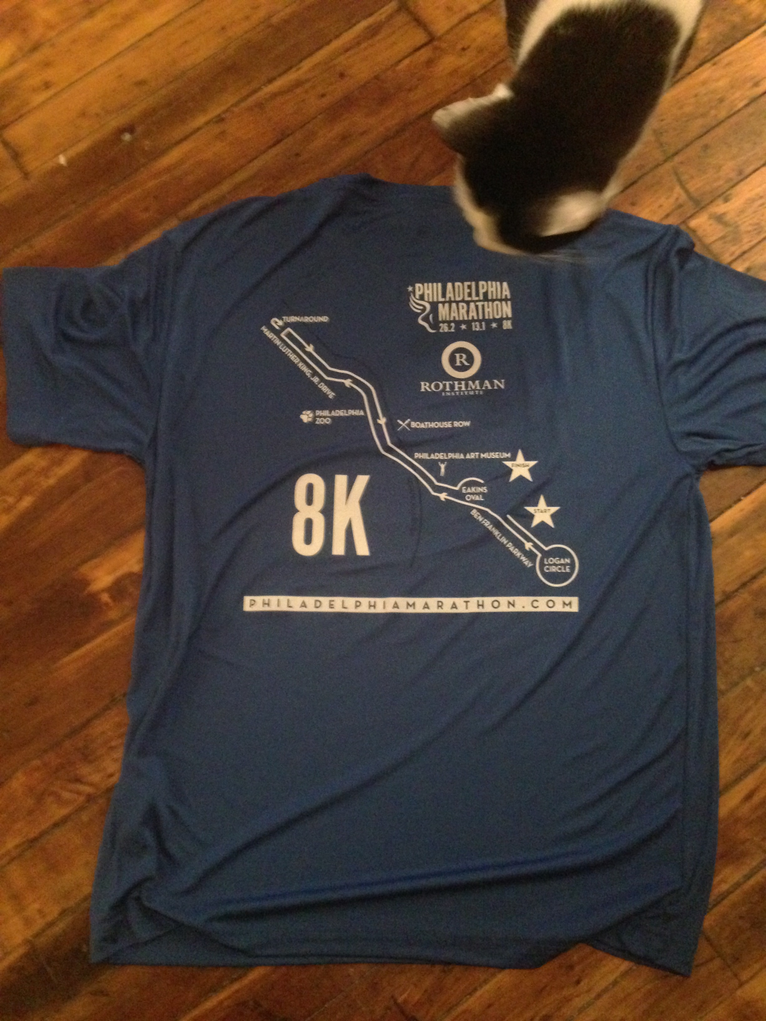 Diego checks out the back of the Rothman 8K shirt.  Nice memento, having the course map on the shirt.