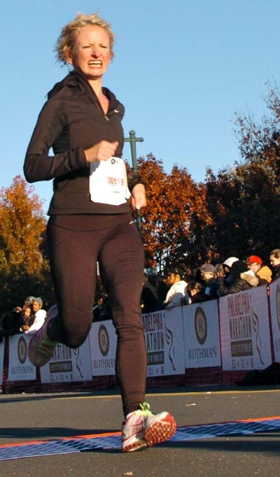 Overheated race face as I crossed the line in one of my first competitive races: the Rothman 8K in 2012. After this, I learned that unless you're racing in Siberia, you should wear shortsand a singlet, not tights and a hoodie. #RunnerNewbieOops