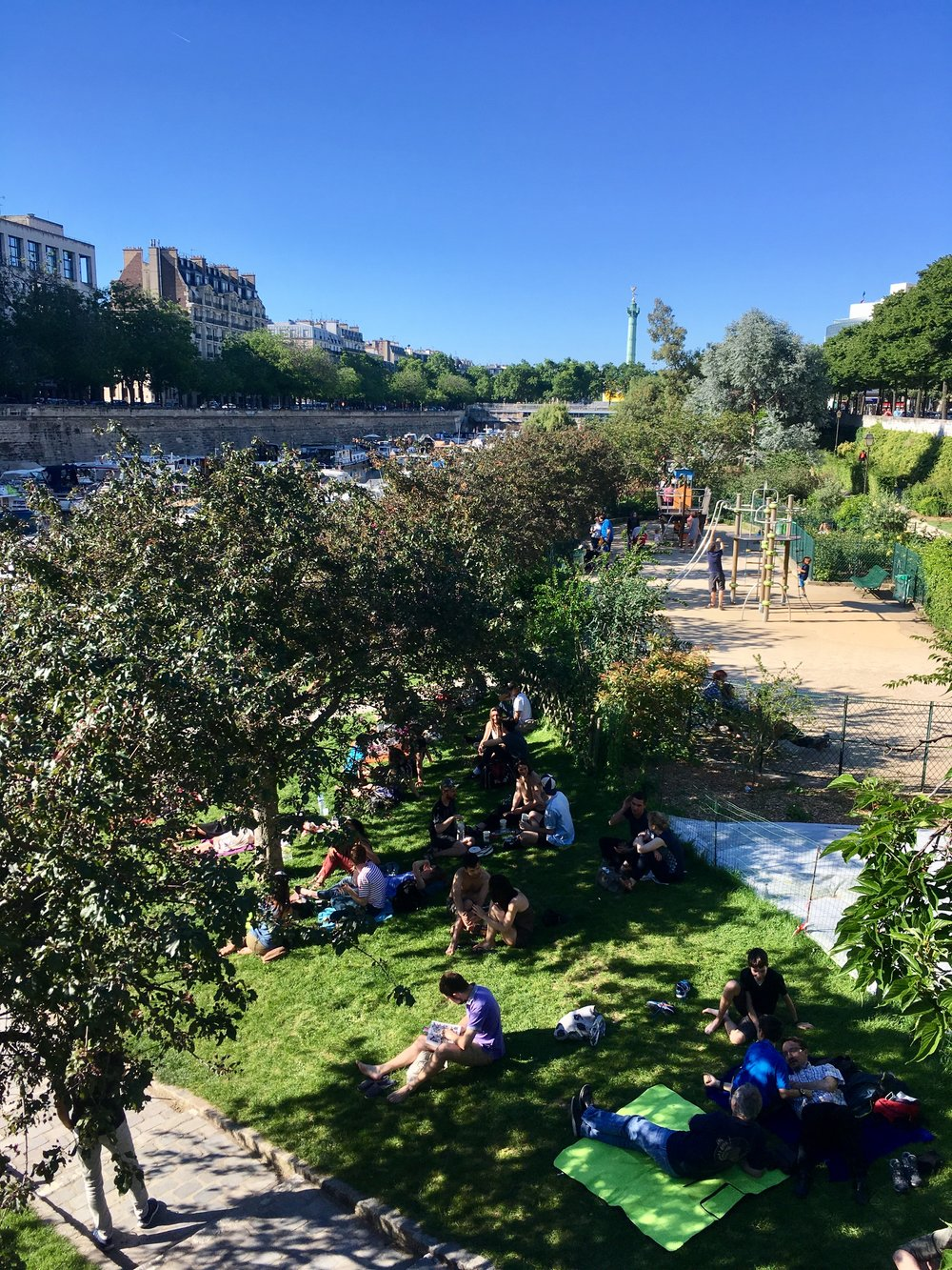Sun's out, fun's out. Paris is lined with beautifully manicured parks and paths and the Parisians take full advantage of them, especially when the weather is nice.