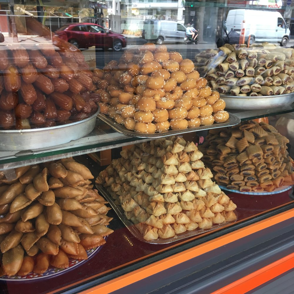 Pyramids of Middle Eastern pastries on display at Le Rose de Tunis