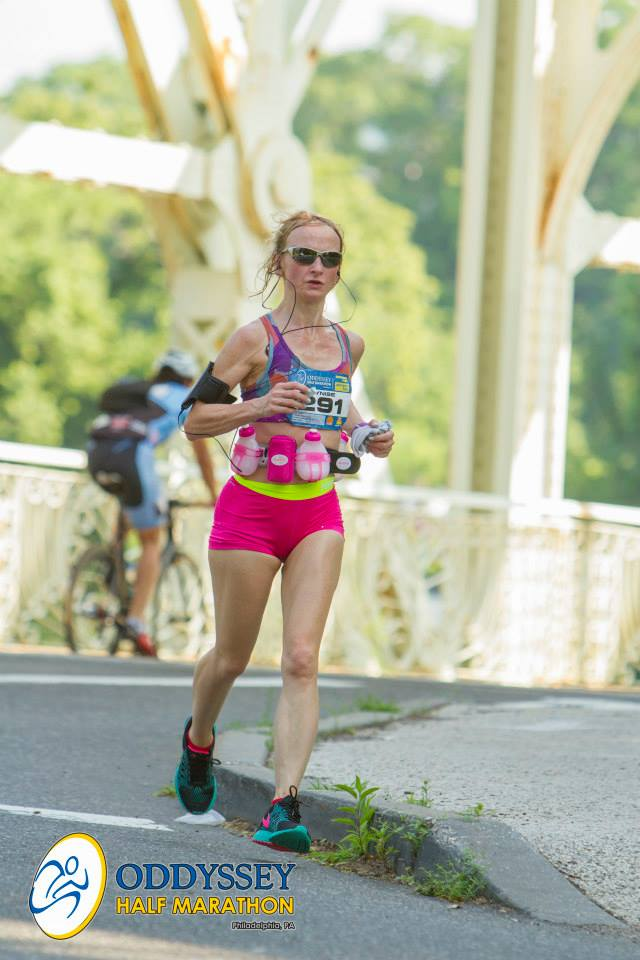 As you can see by how sweaty I am and by the fact that I'm racing with a hydration belt, the weather for the 2015 Oddysey Half Marathon was excruciatingly hot. It was one of those races where the heat took people down. Note the wet washcloth I'm carrying in my left hand.