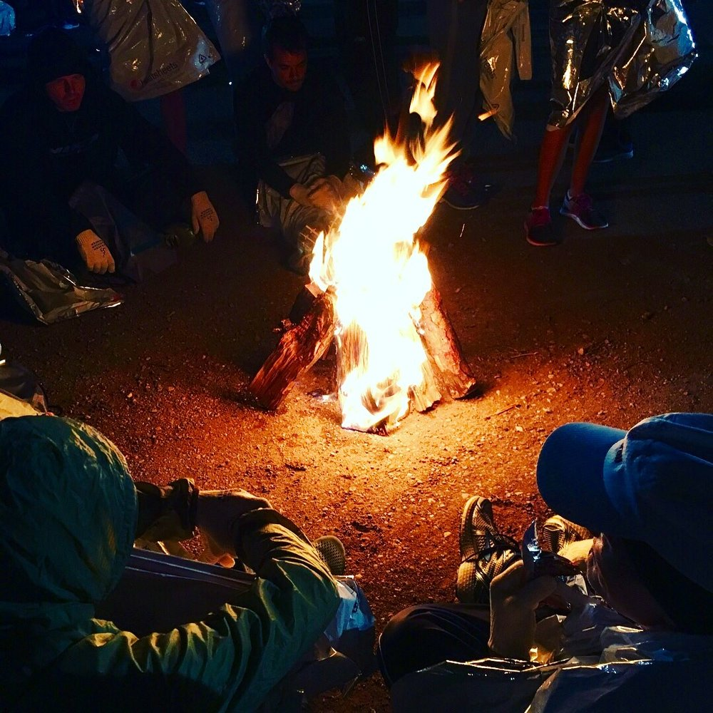 Runners kept warm at the start by huddling around bonfires and wrapping themselves in heat blankets.