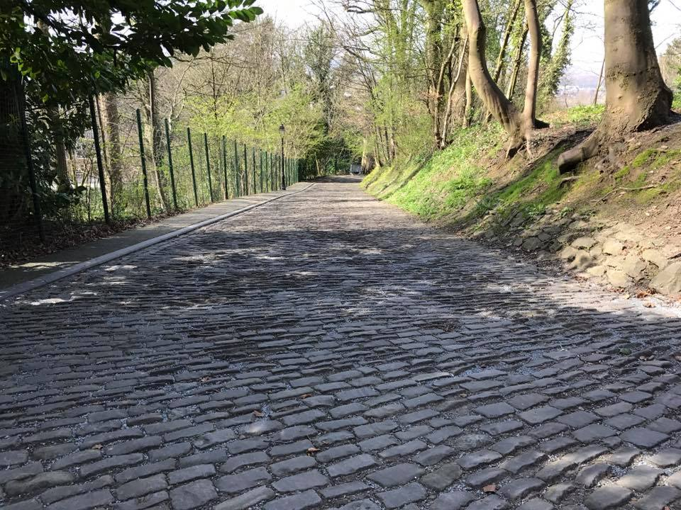 This is the section that precedes the church before it funnels riders between a fine drinking establishment and onto the church section. Zoom in to see how some of these cobbles are like upward facing blades!!