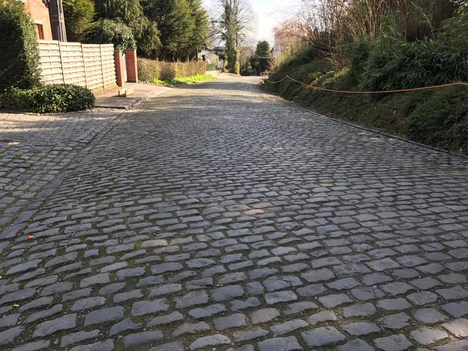 Not all sections of cobbles are equal, this section is more perfectly manicured although far from flat and perilous in the rain with roads narrowed by rabid fans.