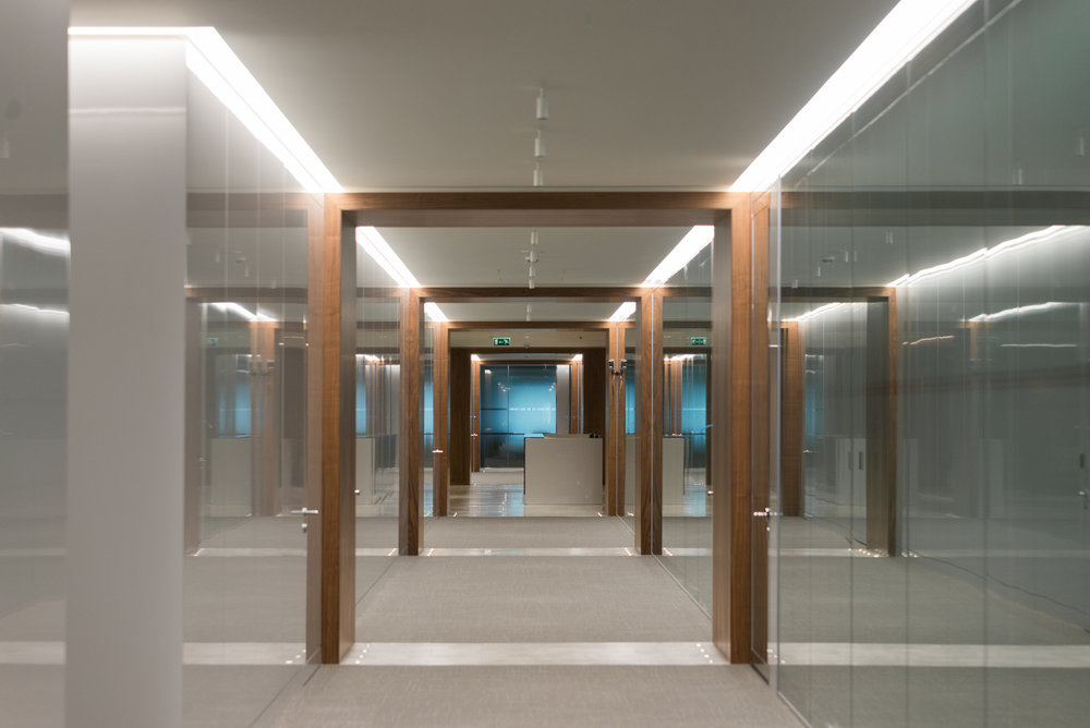 High gloss pigmented lacquer wall panels and doors to the corridor, complete with walnut veneer timber surrounds.