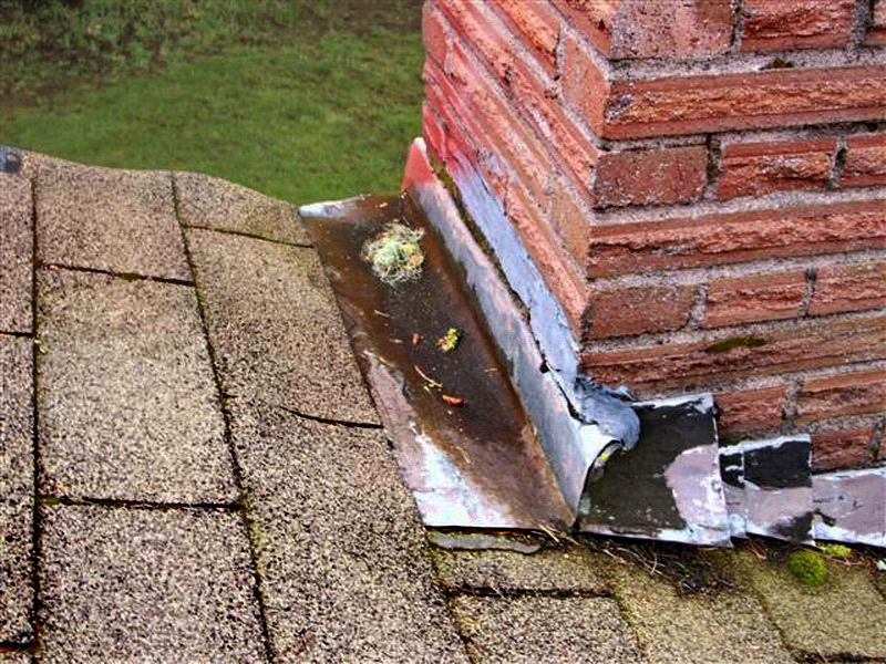 Avalanche Contractors - chimney roof leak.jpg