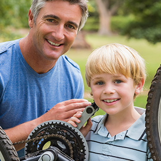 father-and-son-smiling-with-bike.jpg