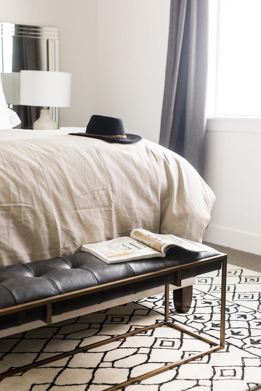 Akin Design Studio | Ironhorse Master Bedroom | Black and gold