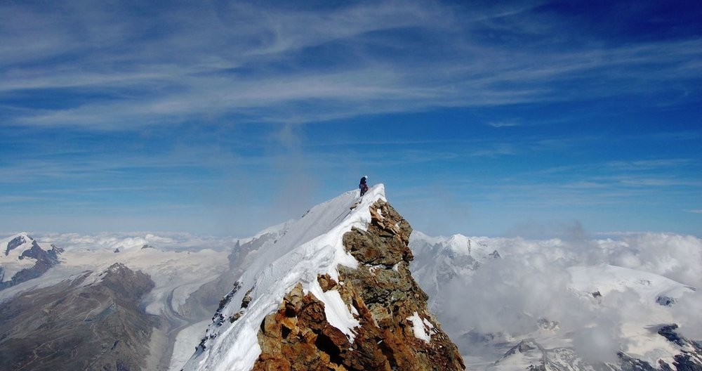 Man on top of the Matterhorn, Hypnotherapy & NLP Edinburgh