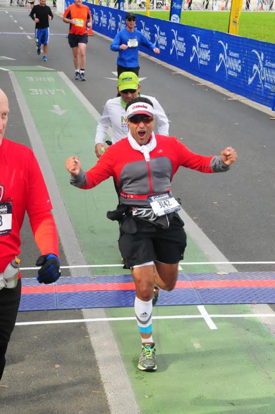Albert D. at CIM December 2016, powerful expression after crossing the finish line of his first marathon