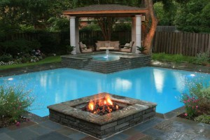 One of our designs in Dallas, Texas. This pool has a fire feature and a fountain in their spa. So cool!